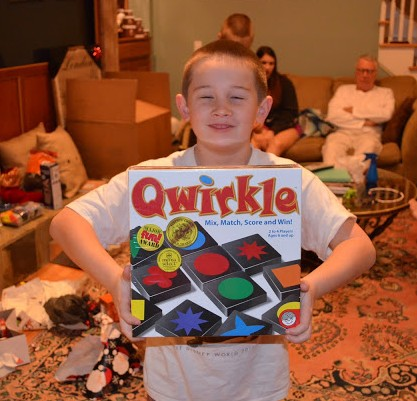 Grandma and Grandpa got Timmy a bunch of brainy games, such as this one, Qwirkle, which he plays at school.