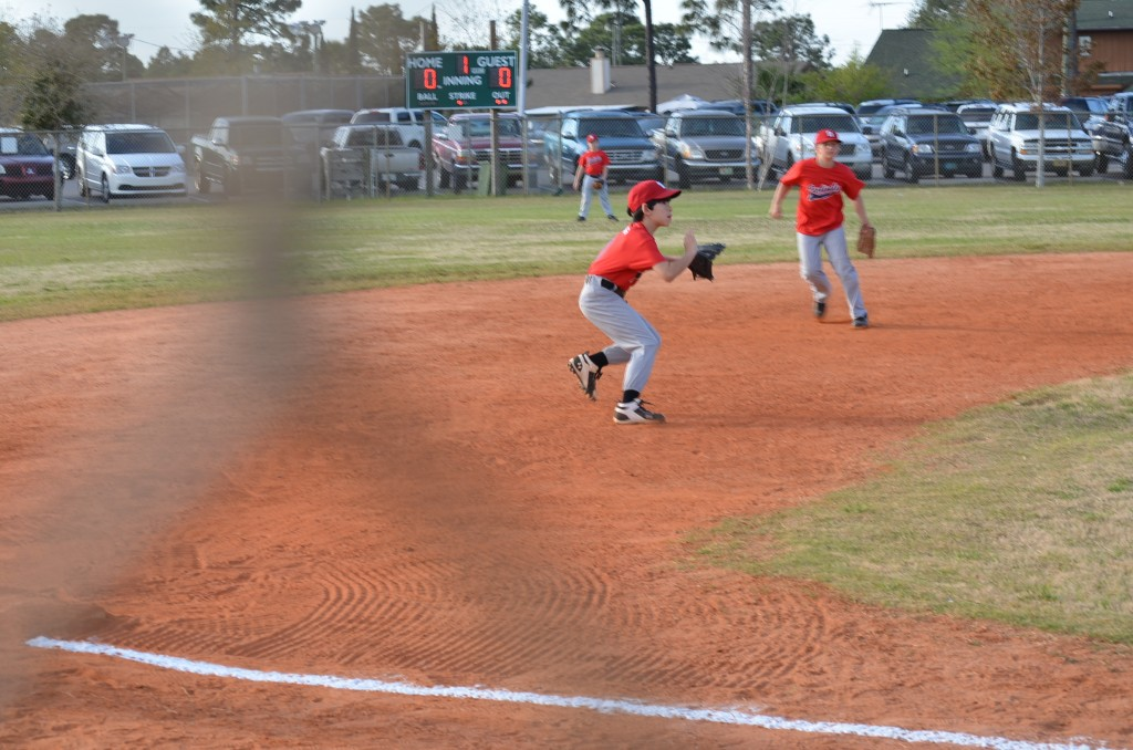 "In this particular game, Jacob is playing 3rd base. If the team is ""small"", he's in the infield. But he's an amazing outfielder, and he is put in center field if the opposing team has older, harder hitting players."