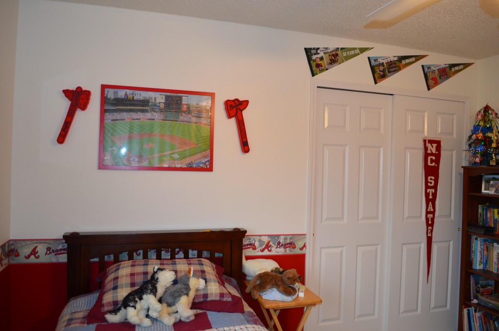 The pennants over the closet were from Timmy's 3 years playing for Navarre Youth Sports.