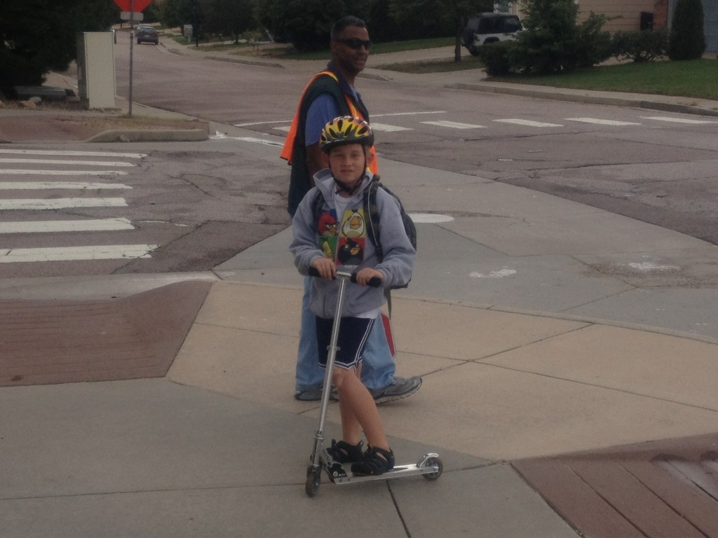 Timmy does a great job on a scooter or bike traveling the 1/2 mile.