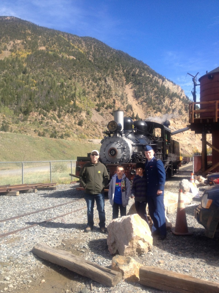 The token photo of the boys in front of a train.
