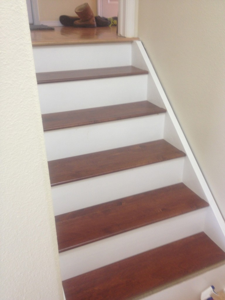 The laminate-floored stairs.
