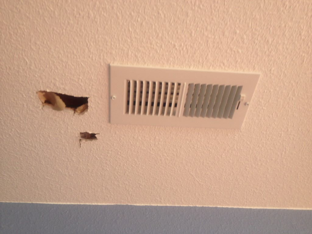 A minor setback. The drywall guy had covered up two of the HVAC vents. The HVAC guy had to poke holes in the ceiling to look for the vent. The drywall guy was very apologetic and came the very next day to patch up the holes. You'd never know they were there.