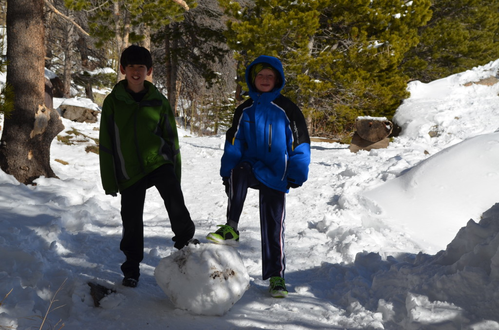 Jacob and his friend found were loving the snow and they found this huge chunk of snow that they were trying to roll down the trail.