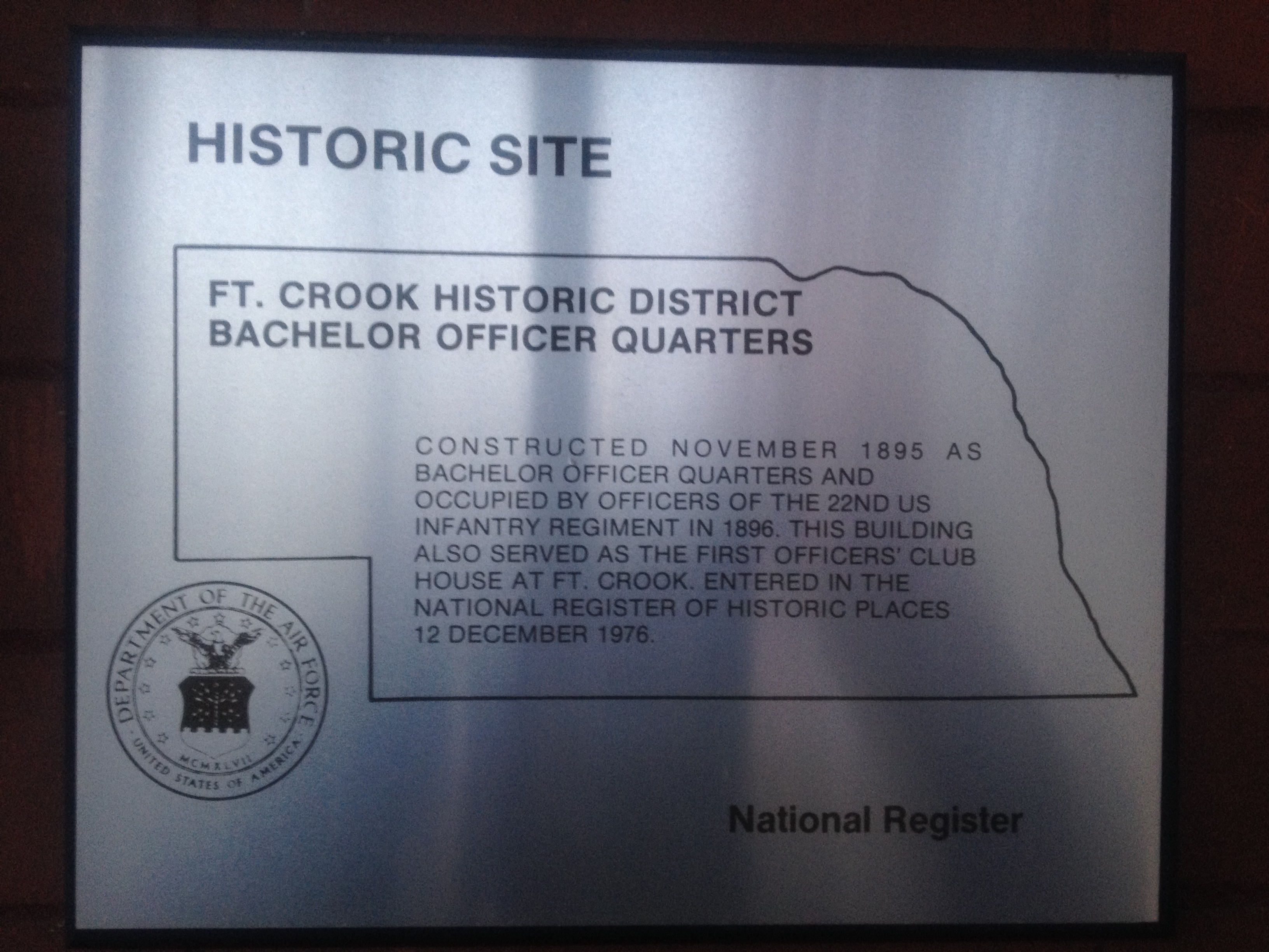 A historic placard with the history of the bachelor officer quarters.