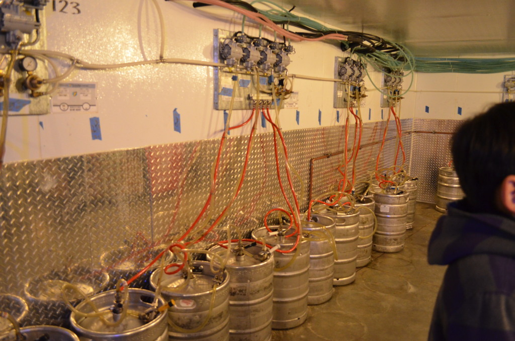 The kegs remain in one place, and the beer is transported throughout the stadium. There is one of these rooms in each quadrant of the stadium, they are managed by different breweries: this one is a Miller-Coors room.