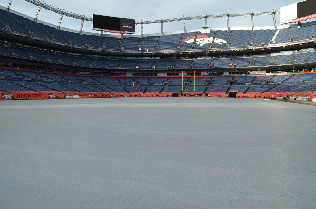 The white tarp looks like it's an ice rink instead of a turf field.