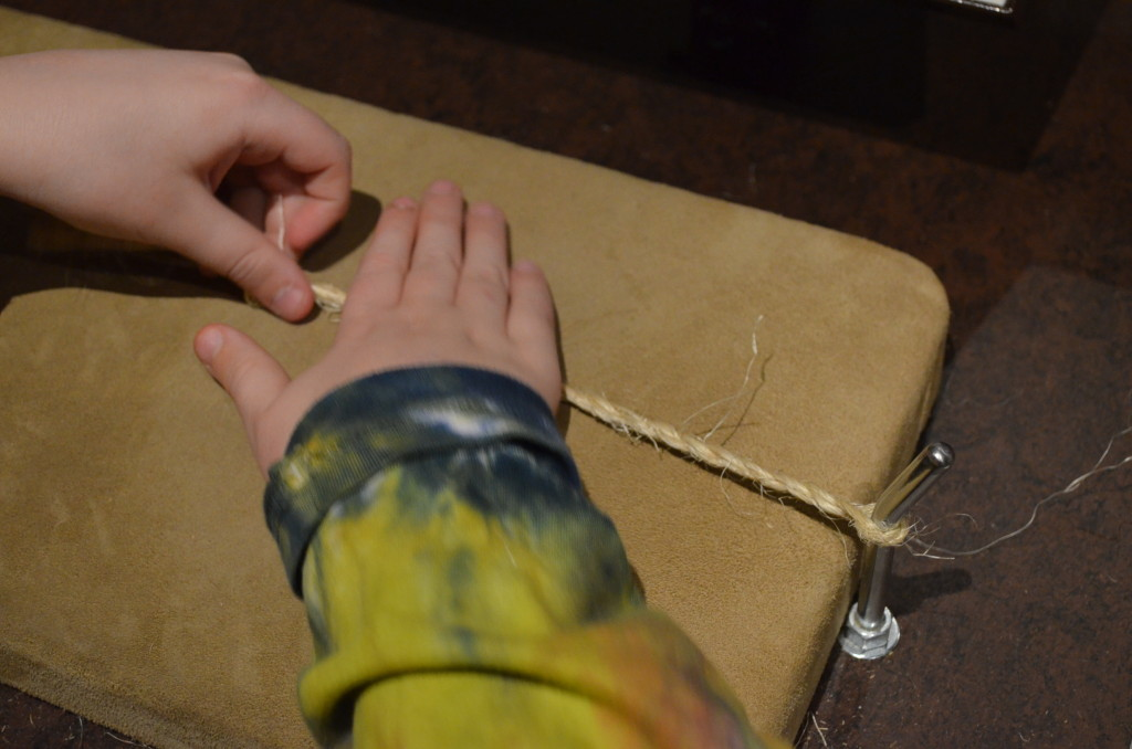 The sueded surface made it possible to roll your hand across with the cord to quickly twist it.