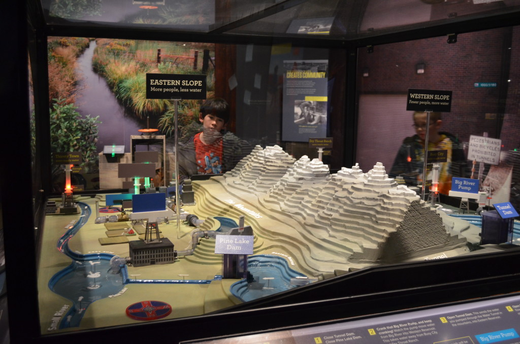 """This was a fantastic demonstration model of how improved water management practices have kept a """"Dust Bowl"""" from happening again. There were switches to flip and wheels to turn which showed the boys the effects on the lakes, reservoirs, and agriculture."""