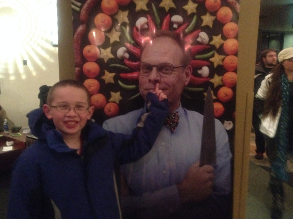 Yes, Timmy's picking his nose. We tweeted this picture to @altonbrown.