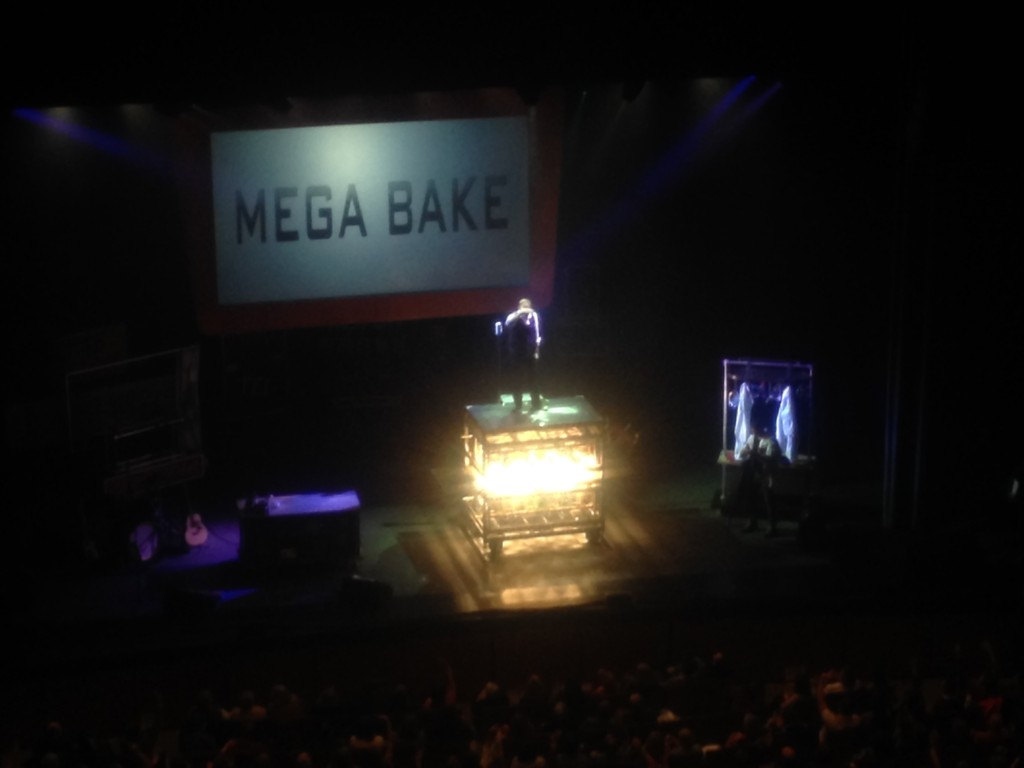 Alton Brown revealing his MEGA BAKE oven, which is an Easy Bake Oven on steroids.