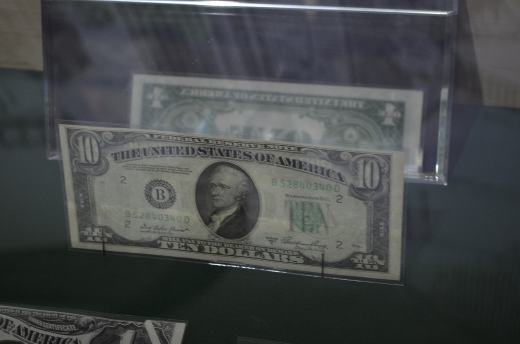 The glass cases had mirrors to show some of the bills that had one denomination on one side, and a completely different denomination on the other.