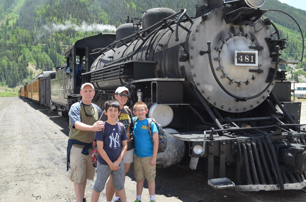 Ubiquitous family photo in front of a locomotive.