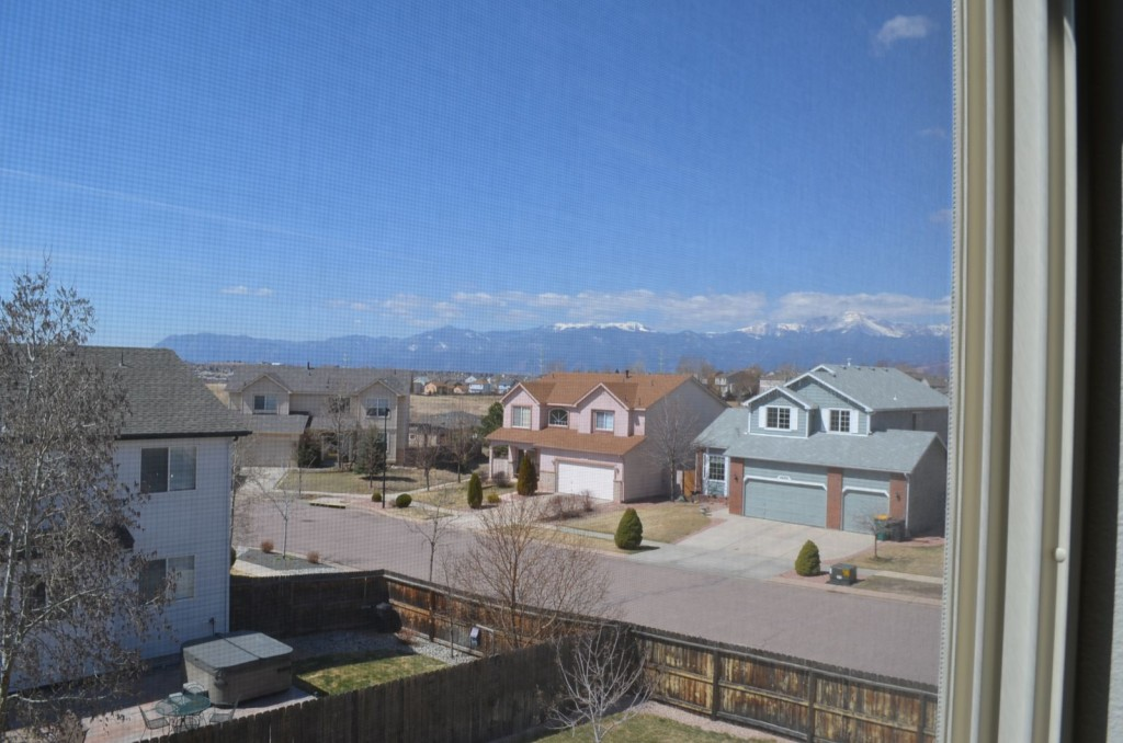 A view of Pikes Peak (on the far right) from the 2nd floor of our house.