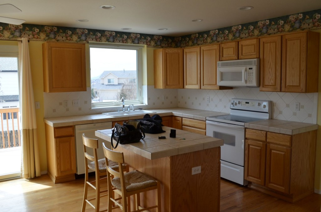 The kitchen the way it was when we bought the house. As of this writing, we took down the border paper, painted the walls, and replaced the stove and microwave.