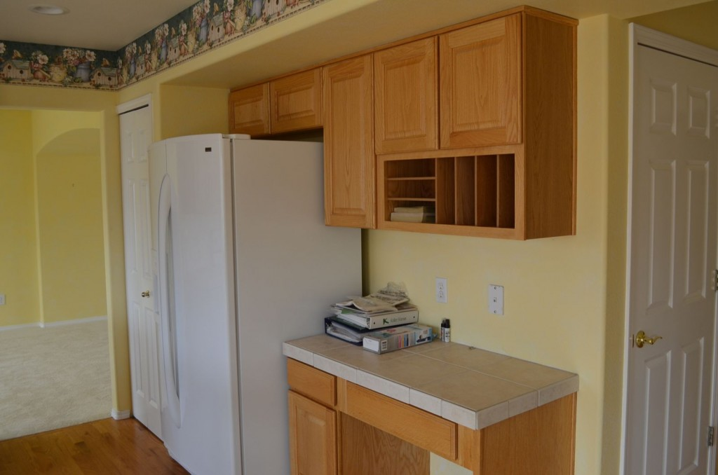 The side of the kitchen with the original fridge.