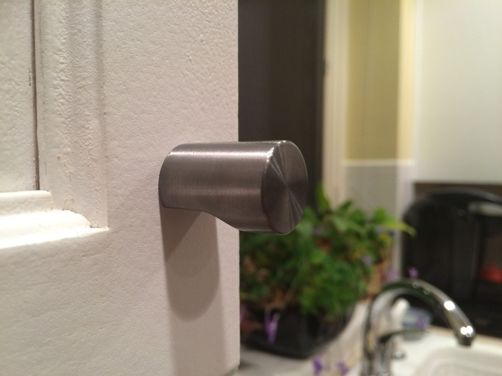 A close up of our swinging cabinet hardware.