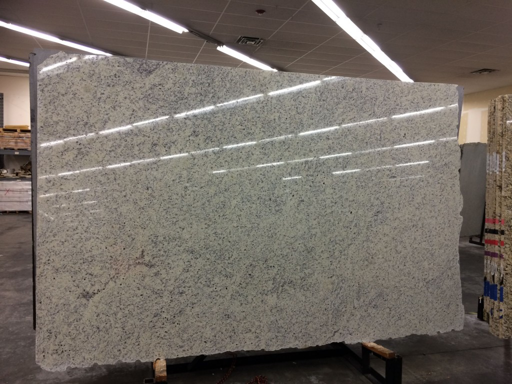 "It was really cool getting to go to the warehouse and choose the slab of granite w wanted. Each slab is unique. The distinctive ""seam"" in the lower left is on our island now."